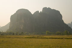 Daily life of Vang Vieng village with limestone mountains, Laos Stock Photos