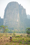 Daily life of Vang Vieng village with limestone mountains, Laos Royalty Free Stock Images