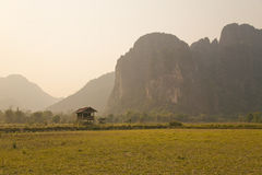 Daily life of Vang Vieng village with limestone mountains, Laos Stock Image