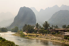 Daily life of Vang Vieng village with limestone mountains, Laos Stock Photo