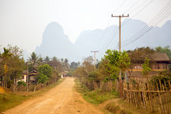 Daily life of Vang Vieng village with limestone mountains, Laos stock photography