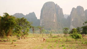 Daily life of Vang Vieng village with limestone mountains,Laos. Day time stock video