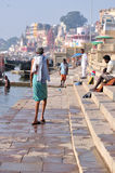 Daily Life in Varanasi. People finishing Washing clothes and bathing on the Ganges River, Varanasi Stock Photo