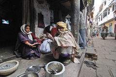 Daily Life of Varanasi People. February 10,2012 Benaras,Uttar Pradesh,India,Asia-A poor family in the by-lane of Varanasi Stock Photography