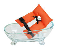 Life Vest and Bathtub. Life vest with security belts in a bathtub for nautical safety - path included royalty free stock photo