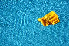 Life vest floating. In a pool stock images