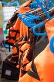 Life vest. Group of orange life vest stock photo