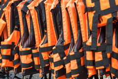 Life vest. Group of orange life vest royalty free stock images