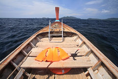 Life vest and snorkel on wooden boat for diving Stock Photography