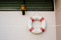 Life vest on white wall. Closeup decoration design of life vest on white wall background royalty free stock photos
