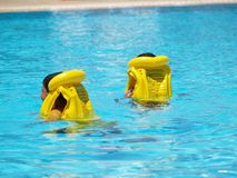 Life vests. 2 young swimmers with life vests Royalty Free Stock Photo