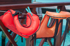 The life vests hang on a clothesline Royalty Free Stock Photography
