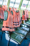 Life vests. Life vest jacket on the seats of an old ferry in thailand royalty free stock photos