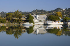 Life on the water 4. Nice houses with boats are reflected in calm waters of Corte Madera Creek in Larkspur, California Stock Image
