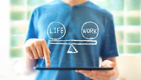 Life and work balance with man using a tablet royalty free stock images