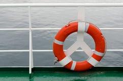 Lifebelt. Detail of lifebelt and ship's fence on the large cruiser Stock Photography