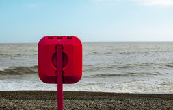 Lifebelt on an English Beach Stock Images