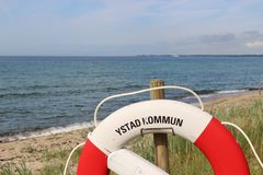 Lifebelt in front of the Baltic Sea. royalty free stock photo