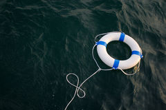 Lifebelt, lifebuoy in a dangerous sea for help, safety,security Stock Photos