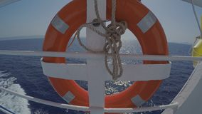 Ferryboat Orange Lifebelt. Lifebelt On A Moving Ferryboat Traveling The Aegean Sea On A Sunny Summer Day stock video footage