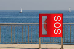 Lifebelt Sos sign. Barcelona beach Stock Photo