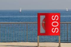 Lifebelt Sos sign. Barcelona beach stock photo