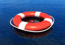 Lifebelt in water. Red lifebelt in calm blue water Royalty Free Stock Image