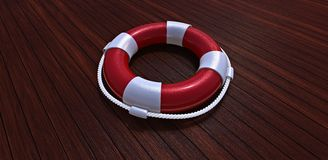 Lifebelt on a wooden floor. Lifebelt on a yacht wooden floor Royalty Free Stock Photography