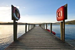 Lifebelts. Two lifebelts symmetrical kept at the pier by Lake District Stock Images
