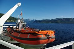 Lifeboat aboard the ferry. Orange lifeboat aboard the ferry Stock Photography