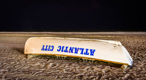 A lifeboat on the beach at night in Atlantic City, New Jersey. Royalty Free Stock Images