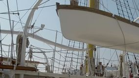 Lifeboat on Board a large sea yacht. Yacht equipment. Slow motion. Lifeboat on Board a large sea yacht. Ropes and hawsers on a boat. Slow motion stock video footage