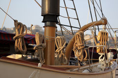 Lifeboat detail. A vision of an ancient lifeboat with ropes and knots Royalty Free Stock Image