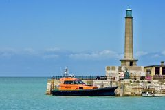Free Lifeboat Docked By The Lighthouse Stock Photo - 156667750