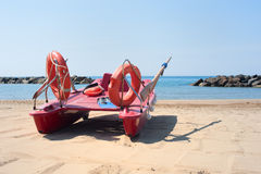 Lifeboat on empty beach in summer day Stock Images