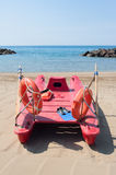 Lifeboat on empty beach in summer day Royalty Free Stock Images