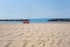 Lifeboat on empty beach in summer day Stock Photography