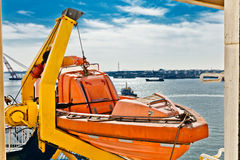 Lifeboat hanging on a deck of vessel Royalty Free Stock Image