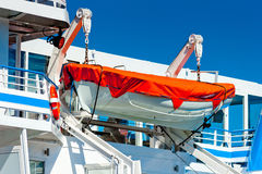 Lifeboat hanging on  ship Stock Photos