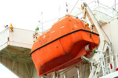 Lifeboat hanging on vessel. Royalty Free Stock Photography