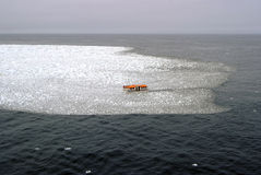 Lifeboat inside an icy water with snow, glaciers Stock Photo