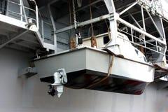 Lifeboat. Gray boat hanging on ship royalty free stock photo