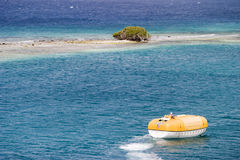 Lifeboat Near Desert Island Royalty Free Stock Photo