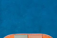 Lifeboat over Deep Blue Waters. A bright orange lifeboat over deep blue Caribbean waters Royalty Free Stock Image