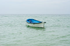 Lifeboat with paddle. Royalty Free Stock Images