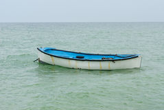 Lifeboat with paddle. Stock Images