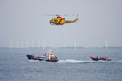 A lifeboat is practicing with a rescue helicopter Stock Image