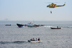 A lifeboat is practicing with a rescue helicopter Royalty Free Stock Images