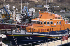 Lifeboat at the ready. Lifeboats are a necessity for marine recreation, shipping and travel. This one at Mallaig is moored in the western Hebrides islands of Stock Photo