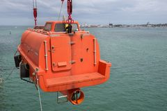 Lifeboat. Orange lifeboat after rescue operations stock images